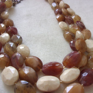 Jewelry - Three strang bead necklace in warm tones